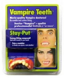 Зубы вампира с клеем