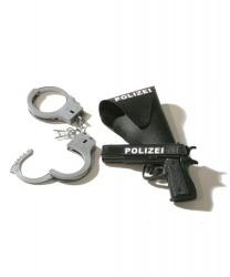 Наручники и оружие полицейского